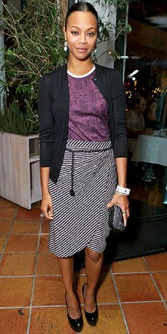 ZO� SALDANA in a striped wrap skirt, printed tee and cardigan at a Marie Claire dinner in West Hollywood.