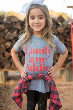 KIDS Candy cane addict t-shirt grey. This totally trendy kid's Christmas t-shirt is a must have for this Holiday season. Charli is wearing size 4. 50% cotton 50% polyester.