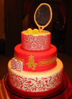 3 tiered Chinese themed birthday cake with long life character and golden tennis racket and balls