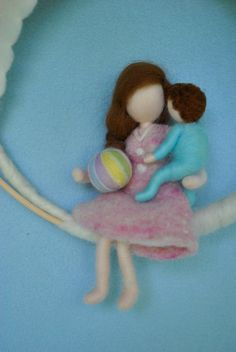 This is a Waldorf inspired piece made of wool by the needle-felting technique. Its been created to provide a peaceful and harmonious image that communicates with the soul through its colors, textures, forms and energy.  Dimensions: 9.5 in diameter Doll: 7 in   SHIPPING: Since shop-home is located in Montréal, contact the shop owner for more accurate delivery-time and shipping-costs.  Note: it is not a toy.