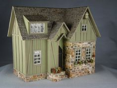 Sparrow Cottage by Sue Herber... pinned because of the diagonal siding/interest to the piece for potting shed