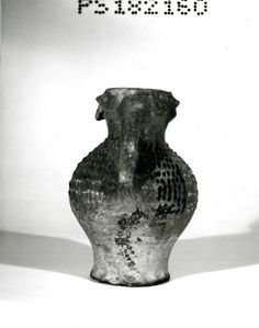 The Grimston Ware face jug in the British Museum. 14th century. From Cambridge. ID no. 1868,0318.10. Height: 28.4 cm; Width: 20.9 cm; Depth: 18.9 cm.