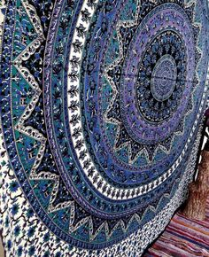 """Mesmerizing medallion tapestry crafted in soft woven cotton. Instantly adds a unique touch of boho charm to any living space or dorm room. Doubles as a beach or picnic blanket and is festival-friendly, too!Content + Care- Cotton- Machine wash- ImportedSize: 90"""" x 85""""Color:Blue ** Please note: Tapestries are hand dyed and sewn in India. Tapestries maylack symmetry in pattern or have stray stitches that need to be trimmed. Tapestries are HAND dyed without a template so each one is…"""