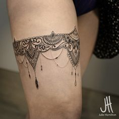 Lace garter tattoo
