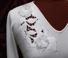 Advanced Embroidery Designs. Free Projects and Ideas.Wild Rose Cutwork Lace machine embroidery design on a knit sweater.