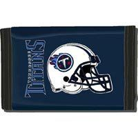 """Tennessee Titans Nylon Tri-Fold Wallet by Rico. $7.85. 3 sewn in pockets and 4 plastic display pockets. Officially licensed by the National Football League. Features vibrant team colors and logos. Measures approximately 4 7/8"""" x 3 1/8"""". Made of durable nylon with helmet logo print. This officially licensed trifold wallet is made of durable nylon and features a full size team logo printed on the middle fold. Complete with three sewn in pockets and four plastic display pockets,..."""