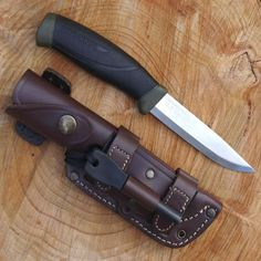 It's time to buy another Mora knife. These knifes kick ass for the price and hold one seriously sharp edge! Mora Knife TBS Firesteel Combo with TBS Leather Sheath - Choose your model Survival Equipment, Survival Tools, Survival Knife, Edc Tools, Wilderness Survival, Bushcraft Knives, Bushcraft Camping, Axe Sheath, Tactical Knives