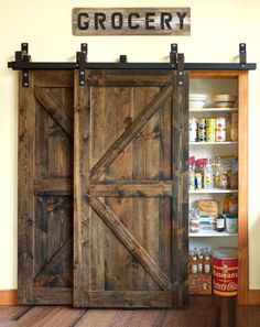 Give your pantry a farmhouse look with sliding barn doors! http://www.dongardner.com/. #Kitchen #Pantry #HomeDesign