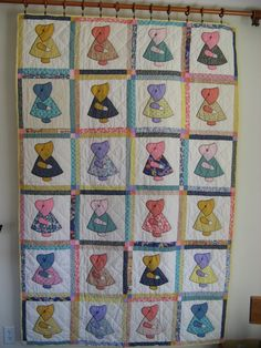 Scrappy Sunbonnet sue quilt.  Hand quilted.