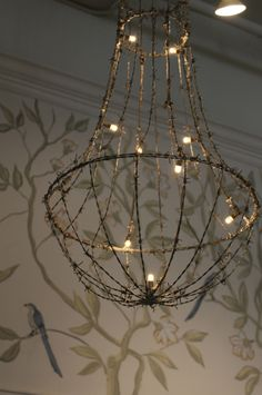 veryyyyyyyyyyyy cool......a barbed-wire hanging light. Perfect for the garden