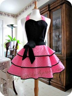 Eye-Candy for Valentine. Sexy, Fancy Retro Apron, vintage inspired pink apron and black hostess apron.. $69.00, via Etsy.