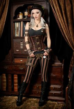 "Here's Kato modeling a corset for Ethereal Threads. From Kato: ""Everything else including bookcase, curtains etc but excluding hat and boots, hand-made. :) This was shot in my office at home"" You're going to be seeing a lot more of that office on SteamGirl, launching soon!"