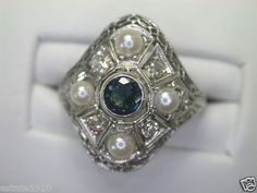ANTIQUE ART DECO SAPPHIRE & DIAMOND ENGAGEMENT RING RE-283    {International Buyers Are Responsible For Customs & Duty Fee's}      CIRCA ~ 1930'S    NATURAL SAPPHIRE ~ .35 CARAT      4 EUROPEAN CUT DIAMONDS ~ .25 CARAT TOTAL WEIGHT    COLOR ~ F - G    CLARITY ~ VS 2 - SI 1    4 CULTURED PEARLS ~ APPROXIMATELY 3 MM EACH    METAL ~ PLATINUM    WEIGHT ~ 4.3 GRAMS    FINGER SIZE ~ 5.75  (SIZABLE) U.S.A. & CANADA (Inquire About Sizing Cost)