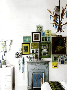 My hunt for art has seen a few etsy buys grow to be enough for a gallery in little boy's room; I could hang the artwork in an eclectic cluster, like this by Liza Giles of Designer's Guild...