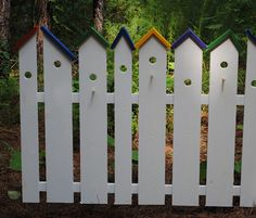 Birdhouse garden fence - Here the pickets are merely capped but including physical bird houses would provide many options for bird homes!