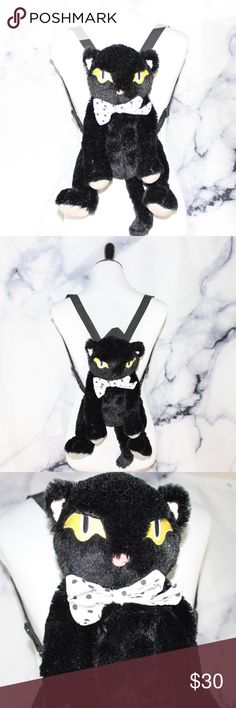 """Black Cat Plush Back Pack Goth Punk Anime Very soft. Clean plush. Excellent used condition. Fur is vibrant black. Eyes are yellow. Paws are gray fleece. Inside there's very slight yellowing of the canvas lining. Cat 12"""" L Head to butt, 21"""" L Head to tail, 6"""" zipper, 16.5"""" fully extended straps. 🖤THANK YOU for supporting our dream 🖤We ship daily M-Sat 🖤no price discussion in comments🖤 use offer button 🖤reasonable offers accepted 🖤low offers countered🖤offers below 50% of asking price…"""