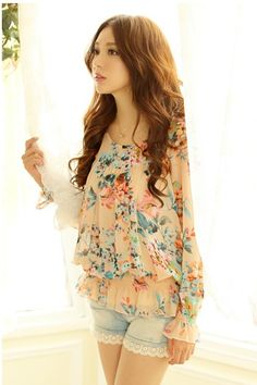 A very cute floral blouse with the denim shorts, which would be a cute outfit for warm spring or summer days.