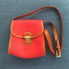 Dooney and Bourke Small Purse Older style Dooney and Bourke red leather purse.  Genuine leather, clasps shut.  Inside has a single leather pocket. Dooney & Bourke Bags Mini Bags