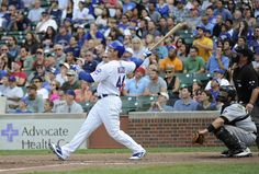 9/16/12 Anthony Rizzo of the Chicago Cubs hits a grand slam home run against the Pittsburgh Pirates at Wrigley Field in Chicago, Illinois.