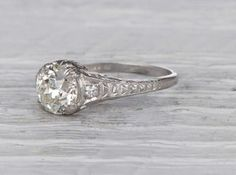Early Art Deco engagement ring set with an old European-cut diamond weighing approximately 1.28 carats with an EGL certificate stating the diamond is I-J color/SI1 clarity. Set in platinum. Circa 1920 This classic ring features fine hand engravings, millegrain edges, and an elegant low profile. Learn about Edwardian era engagement rings. Diamond and gold mining has caused devastation in areas such as Africa, wreaking havoc on delicate ecosystems and communities. Choosing to go vintage, y...