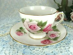 Vintage Porcelain Teacup with Pink Roses by by HappyGalsVintage