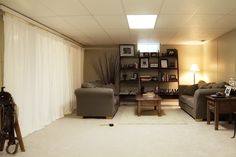 Could use a curtain track system to hide the gray cement walls in an unfinished basement
