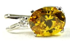 SP020, 10x8mm, 3.3 ct Golden Yellow CZ, 925 Sterling Silver Pendant * Stone Type - Golden Yellow CZ * Approximate Stone Size - 10x8mm  * Approximate Stone Weight - 3.3 ct  * Jewelry Metal - Solid .925 Sterling Silver  * Our Warranty - A full year on workmanship  * Our Guarantee - Totally unconditional 30 day guarantee