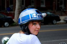 """R2-D2 Helmet: Artist and creator Jenn used some tape and paint and turned an old bike helmet into a awesome R2-D2 helmet."""