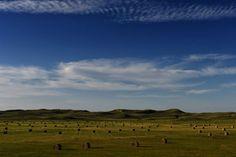 The Nebraska Project Hay bales beneath a Cherry County blue sky