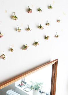 dried rose garlands above mirror, gardenista