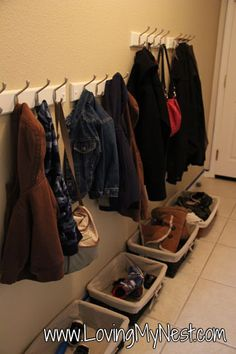 Coat and shoe organization for the hall entry way.