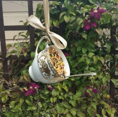 Pretty vintage fine china teacup and vintage teaspoon up-cycled bird feeder. As featured in the harrogate Autumn flower show 2015. White china