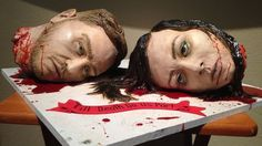 Creepiest wedding cake! Severed heads of the bride and groom, for a couple that is obsessed with all things horror