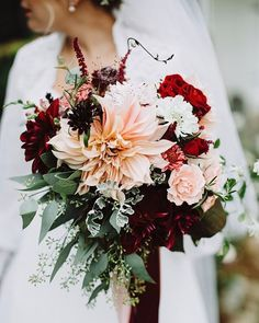 henkaaBurgundy Dahlia wedding bouquet softened with blush pink and lush green accents. (Via @ruffledblog, by @withloveandembers)
