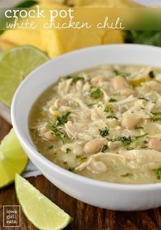 Crock Pot White Chicken Chili is a hearty and filling, gluten-free crock pot recipe. You'd never guess it's low-fat, too! | iowagirleats.com