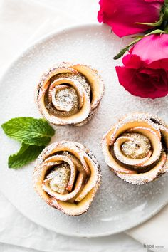 Super flaky puff pastry, rich and creamy Nutella, and sweet apples rolled into beautiful rose-shapes. They're deceptively easy to make and totally delicious!