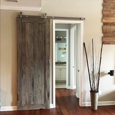Beautiful distressed door perfect for providing privacy from the rest of the living space.  Via: @skwalsh33