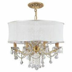 """Pairing a sheer drum shade and dazzling crystal-inspired drops, this glamorous chandelier casts a stylish glow.   Product: ChandelierConstruction Material: Steel, crystal and fabricColor: White and goldFeatures: UL and cUL listedAccommodates: (12) 60 Watt candelabra base bulbs - not includedDimensions: 29"""" H x 30"""" Diameter"""