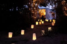 Another simple and extremely cost effective idea is to create luminaries to line paths or aisles using small paper bags, votive candles, and sand.