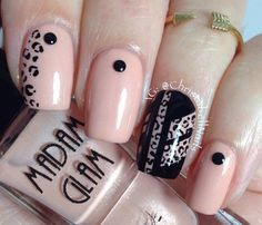 Pink and black leopard nail art design. Simple and stunning winter nail art combination. Additional black beads have been added on top to complete the effect.