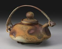 """Richard Bresnahan, Raku  (Yes, Bresnahan's work---St. John's Pottery, Collegeville, MN....I was fortunate to fire one of my pieces in his """"Johanine Kiln"""", holding 10,000 pieces wood fired 24/7 for two weeks....An amazing process....Thanks for sharing....he has  an artistic friend that does these special teapot handles....):"""
