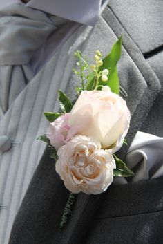 Bride Groom's Boutonniere of fresh fragrant Lily of the Valley, Keira English Garden Rose, a Bombastic Rose with florest of Sweet Peas and Thalaspi