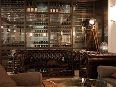 Wine cellar works as a great backdrop for a cigar lounge