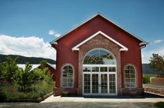 The Courtyard provides a beautiful backdrop with an array of Colorado wildflowers and unique arched doors. Weddings at The Venue at Crooked Willow Farms, Larkspur, Colorado.