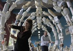 Mary Johnson and Anthony Pescatore tap out a tune on a whale bone sculpture made of trash recovered from the sea at the Washed Ashore interactive percussion art exhibit at the SF Zoo in San Francisco, Calif. on Friday, May 23, 2014. Zoo visitors will be encouraged to rap, tap and bang on a variety of giant sea life sculptures, created from 11 tons of debris found floating in the Pacific Ocean, that will be on display in the Pachyderm Building until Sept. 23. Photo: Paul Chinn, The Chronicle