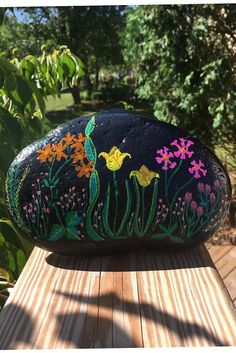 This Flower Garden at Night hand-painted rock will make a one of a kind housewarming gift for that special friend, deserving teacher, gardener who has everything, or yourself. If you like what you see in the pictures and video, you'll be pleasantly surprised when you receive the rock and see the details and contours that can only be seen in person. Painted Rocks For Sale, Hand Painted Rocks, Unique Housewarming Gifts, River Stones, Rock Art, House Warming, Contours, Garden, Flowers