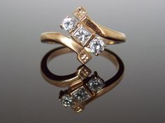 Victorian Bypass Diamond Cocktail Ring with Princess Cut Diamond Toi Et Moi Antique Vintage Unique Engagement Ring RGDI38 $845.00 USD Only 1 available  Overview      Vintage item from 1900 - 1909     Materials: 10K Yellow Gold, Princess Cut and Round Diamonds     Feedback: 226 reviews     Ships worldwide from Boston, Massachusetts