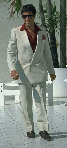 Al Pacino as Tony Montana in Scarface Estilo Miami, Montana, Mens Tailored Suits, Scarface Movie, Cordovan Shoes, Gangster Movies, Photographie Portrait Inspiration, South Beach Miami, Pinstripe Suit