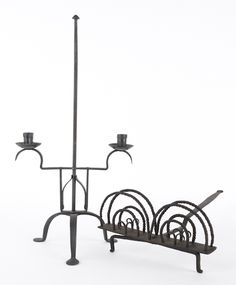 """Wrought iron revolving toast rack, 19th c., together with a contemporary iron candleholder, 23 1/2"""" h."""