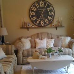 Large Wall Design Ideas large wall decorating ideas above couch with floral wall art decor and flat screen tv on Large Wall Clock On Shelf